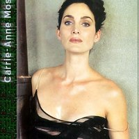 Carrie Anne Moss Brunet MILF with deep cleavage