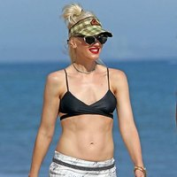Gwen Stefani posing on a beach