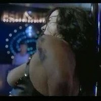 Jennifer Tilly as a strip dancer in Dancing At The Blue Iguana