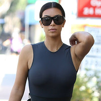 Kim Kardashian Braless In A See Through Tight Dress