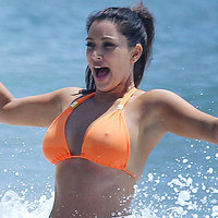 Kim Kardashian in a tight orange bikini