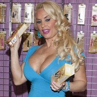 Posh blonde Nicole Coco Austin and her big twins